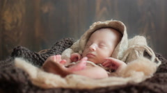 Close up shot of adorable tiny newborn baby sleeping in a lovely pose touching c Stock Footage