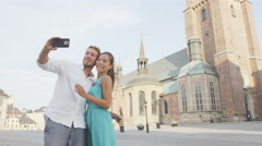 Couple taking smartphone photos in Stockholm city Stock Footage