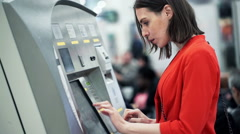 Young woman buying ticket from vending machine at station HD Stock Footage