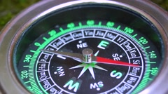 Stock Video Footage of The compass and the arrow is spinning abnormally, large.