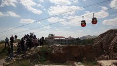 Riding the cable car from Mount of Temptation to Jericho Stock Footage
