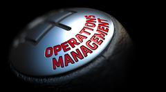 Stock Illustration of Operations Management on Gear Stick with Red Text