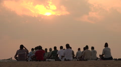 People meditate on the beach during sunrise in Chennai, India Stock Footage