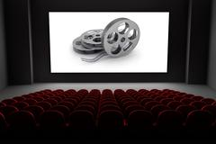 Cinema theater with reels of film on the screen. Piirros