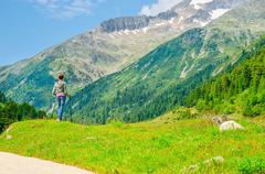 Young female mountaineer with alpine landscape Stock Photos