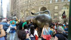 Tourists taking Pictures at Charging Bull Statue Wall Street 4K Stock Footage
