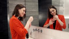Stock Video Footage of Pretty woman painting her fingernails in bathroom  HD