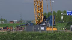 Stock Video Footage of crawler crane lifting rotor blades of a wind turbine - tilt up tower