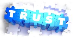 Stock Illustration of Trust - White Word on Blue Puzzles