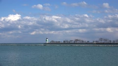 Lake Michigan and Guidewall with the Lighthouse Stock Footage