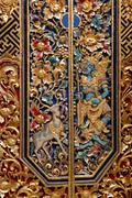 Ornate gilded doors at the temple of Pura Dalem Agung, Sacred Monkey Forest,  - stock photo