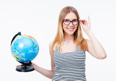 Stock Photo of Happy girl in glasses holding world globe