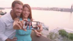Smart phone selfie - couple taking self portrait using smartphone camera Stock Footage