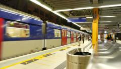 Metro train arrives to platform and opens doors, modern subway in Hong Kong - stock footage