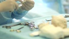 Tray with surgical instruments and used gauze swabs during surgery Stock Footage