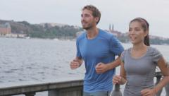 Runners couple jogging in Stockholm city, Sweden - stock footage
