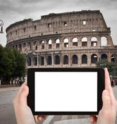 Stock Photo of tourist photographs of Coliseum in Rome