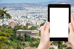 tourist photographs Athens city with Temple - stock photo