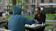 Master playing speed chess with opponent in park; slow motion 4K Manhattan NYC Stock Footage