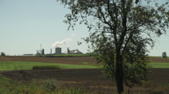 Ethanol Production Plant and Corn Field on a Country Road Stock Footage