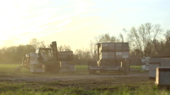 Forklift truck carrying beehives boxes - stock footage