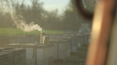 Beekeeper in protective workwear examining beehive - stock footage