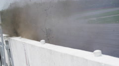 Race cars hitting the wall going around a corner - cloud of dust and dirt Stock Footage
