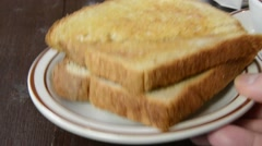 Hot buttered toast Stock Footage