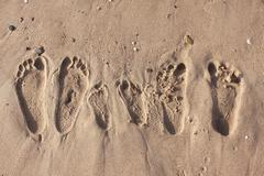 Family footprints on the sand beach in Side, Turkey Stock Photos