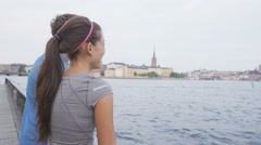 Exercising couple resting after running Stockholm Stock Footage