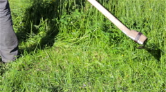 scythe to mow the grass - stock footage