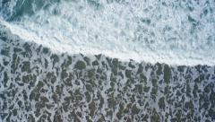Overhead aerial drone footage of serene ocean waves Stock Footage