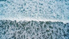 Overhead drone footage of splashing ocean waves - stock footage