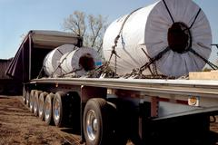 Steel Coils Trucking Stock Photos