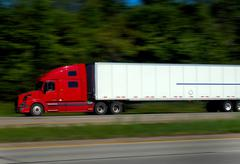 Semi Trucks on Freeway Stock Photos