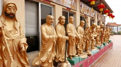 Gold Buddhas statues around building, Main Plaza and pagoda at temple Stock Footage