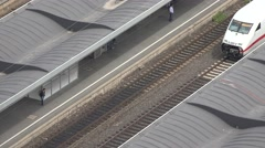 ULTRA HD 4K Aerial view high speed train arrive outdoor station Koln city iconic Stock Footage