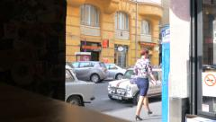 Budapest - Wesselényi Street Looking out door of pub Stock Footage