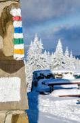 Hiking signs on wall of mountain shelter - stock photo