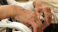 Hands of an old woman on a crutch, hands of a young woman petting them - stock footage