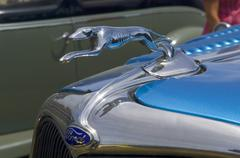 Classic Ford in metallic blue with Ford badge and chrome greyhound mascot Stock Photos