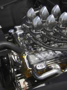 Engine intake carburater manifolds on hot rod - stock photo