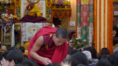 Monk serves rice at a public lesson from the Dalai Lama in India Stock Footage