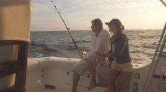 Mature Man And Young Woman On Boat Big Game Fishing Stock Footage