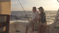 Stock Video Footage of Mature Man And Young Woman On Boat Big Game Fishing