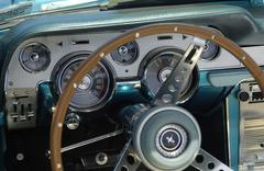 Classic green Chevrolet Corvette interior steering wheel and dashboard with s Stock Photos
