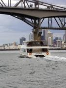 Fullers ferry passing under Auckland harbour bridge, Auckland New Zealand - stock photo