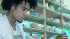 Young people learn the art of pottery Stock Footage