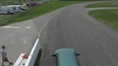 Green station wagon speeds into corner- ShannonVille RaceTrack May 19th Stock Footage