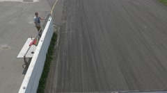 Beige cars drift close to barrier top view2- ShannonVille RaceTrack May 19th Stock Footage